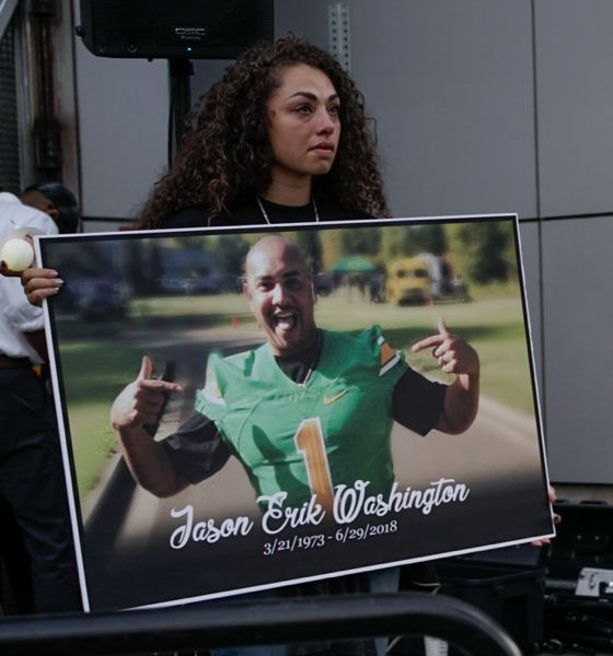 TRIBUNE FILE PHOTO - Jason Washington's daughter holds a photo of him at a July 6 press conference.