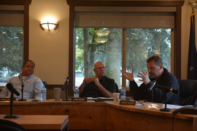 SPOTLIGHT PHOTO: COURTNEY VAUGHN - Port of Columbia County commissioners discuss concerns surrounding a proposed renewable fuels plant at Port Westward during a board meeting Wednesday, Sept. 12. Pictured left to right: Commissioners Chris Iverson, Larry Ericksen and Robert Keyser.