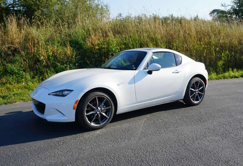 PORTLAND TRIBUNE: JEFF ZURSCHMEIDE - With the retractable hardtop up, the stylish 2018 Mazda Miata RF stays warm and dry enough for winter driving. All versions also got more horesepower this year.