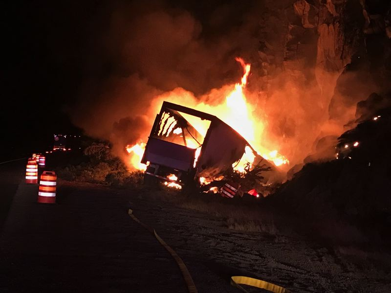 OREGON STATE POLICE PHOTO - The semi truck was engulfed in flames after it left the roadway.