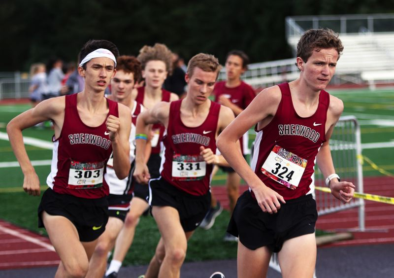 TIMES PHOTO: DAN BROOD - Sherwood senior Henry Giles (right) and junior Jaron Homer (left) finished first and second in the varsity boys race during the Pacific Conference dual meet with Glencoe.