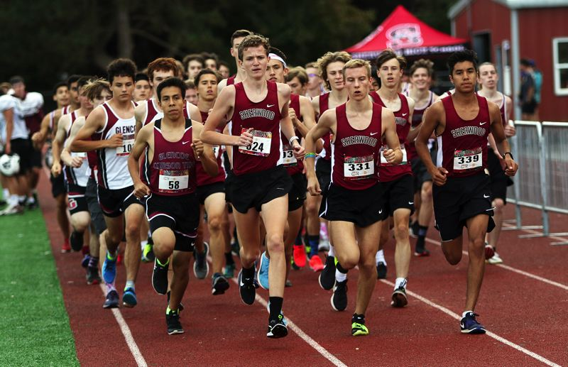 TIMES PHOTO: DAN BROOD - It was a big pack of Bowmen out in front early in the boys race during Sherwoods Pacific Conference dual meet with Glencoe.