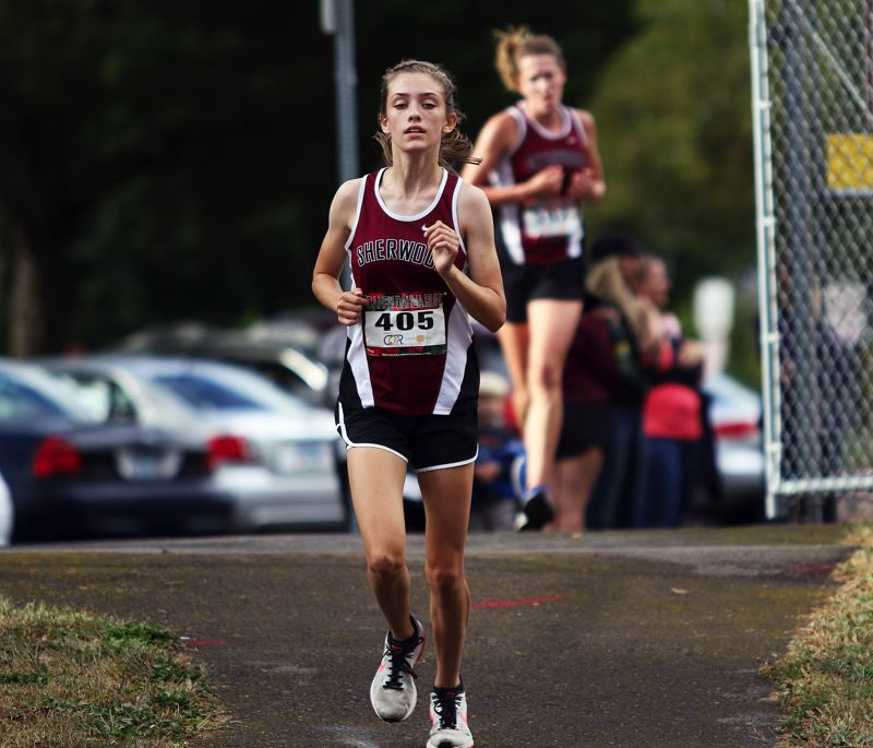 TIMES PHOTO: DAN BROOD - Sherwood sophomore Kari Eddington ran to second place in the varsity girls race during the Bowmens Pacific Conference meet with Glencoe.