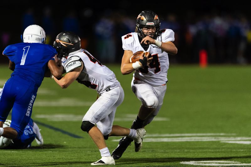 PAMPLIN MEDIA GROUP: CHRISTOPHER OERTELL - Scappoose High running back Connor McNabb gets a block from Gabriel Jacobs on Hillsboro's Elian Lopez-Arana. McNabb scored three touchdowns to help the Indians win 39-14 Friday night at Hare Field.