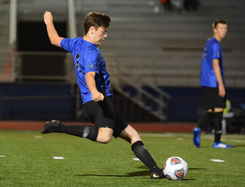 OUTLOOK PHOTO: DAVID BALL - Gresham's Nick Morris clears a ball out of the Gophers' defensive zone during Thursday's 1-0 win over Wilson.