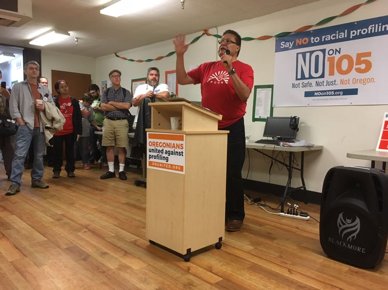 PAMPLIN MEDIA GROUP: PETER WONG - Ramon Ramirez, president of the Oregon farmworker union known as PCUN, speaks Saturday to volunteers before they canvass Portland neighborhoods in opposition to Measure 105 on the Nov. 6 ballot.