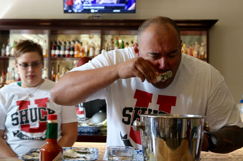 TIMES PHOTO: ZANE SPARLING - First responders gobbled down oysters during the 'Shuck It Challenge' on Saturday, Sept. 15 at Ways & Means Oyster House.