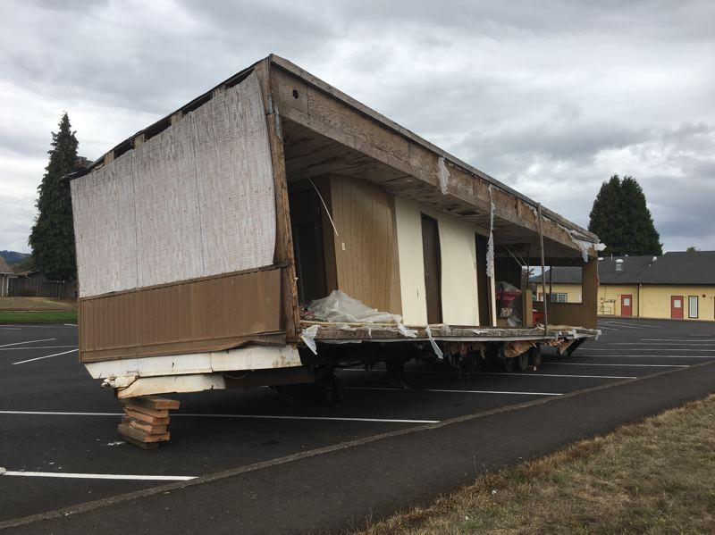COURTESY PHOTO: WASHINGTON COUNTY SHERIFF'S OFFICE - A dilapidated double-wide mobile home was abandoned in the parking lot of Echo Shaw Elementary School in Cornelius on Saturday, Sept. 15.