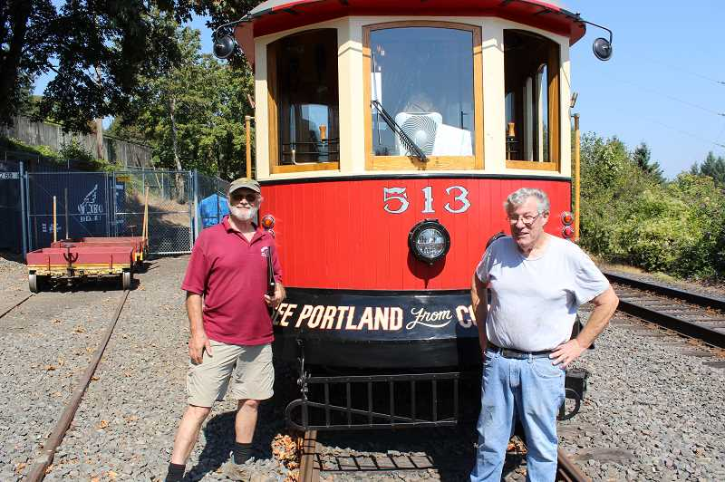 REVIEW PHOTO: ANTHONY MACUK - Volunteers Gerald Fox and Dave Rowe stand in front of Trolley 513, which was recently restored to operational status. The 513 will take over as the lines primary vehicle while its counterpart, Trolley 514, undergoes a retrofit to convert it to a battery system.