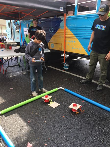 TIMES PHOTO: PETER WONG - Doug Bundy, right, a teacher on the technological innovation team of the Beaverton School District, checks out the creation of Druv Athmanathan of Marysville Elementary School in Portland for a battlebots demonstration last weekend at the Portland Mini Maker Faire.