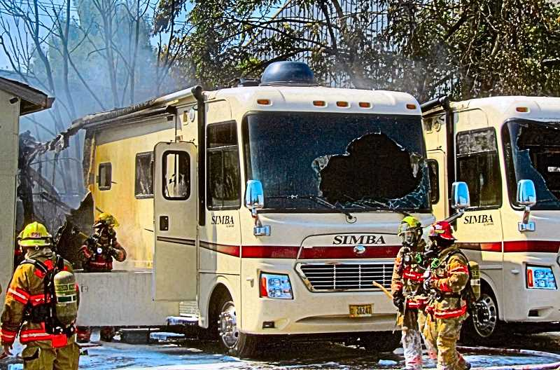 ERIC NORBERG - The entire rear ends of both luxury motor homes were completely burned off in the commercial fire, one and a half blocks south of Holgate Boulevard on S.E. 27th.