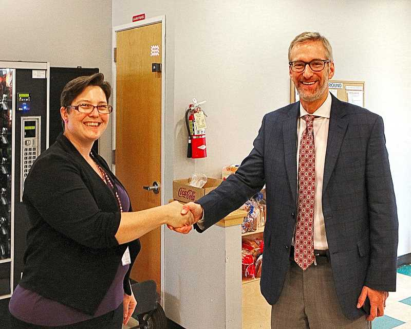 DAVID F. ASHTON - Brentwood-Darlington Neighborhood Association Chair Chelsea Powers welcomes Portland Mayor Ted Wheeler to the BDNA Community Center.