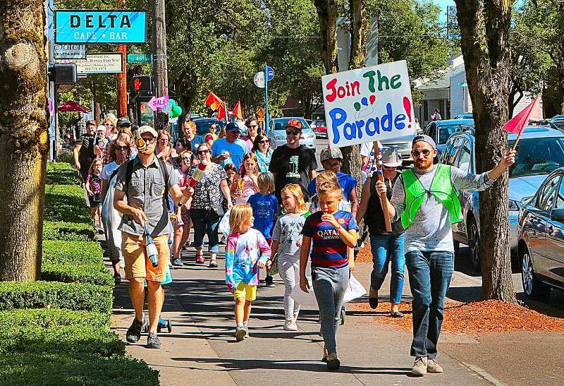 DAVID F.  ASHTON - The Kids Parade down Woodstock Boulevard was one highlight of a special day of celebration, sales, and charity in the neighborhood.