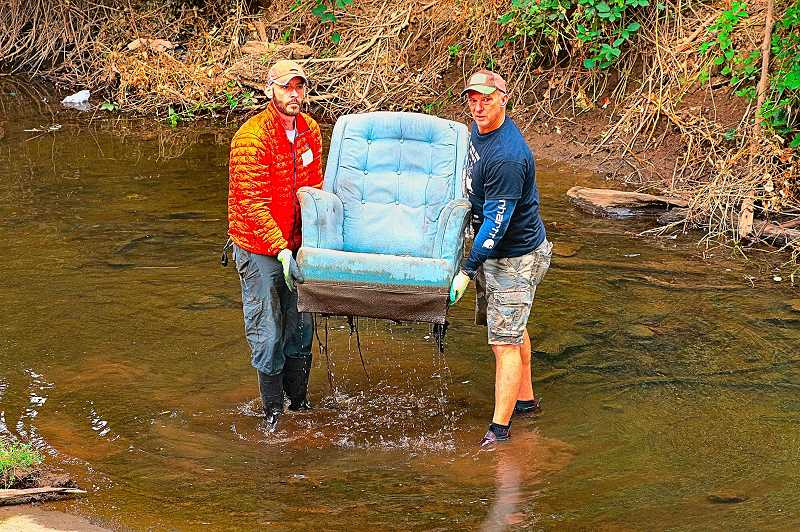 DAVID F. ASHTON - Yes, thats a discarded recliner that Clean-up volunteers Nathan Melton and Mark Beirwagen were muscling up and out of Johnson Creek.