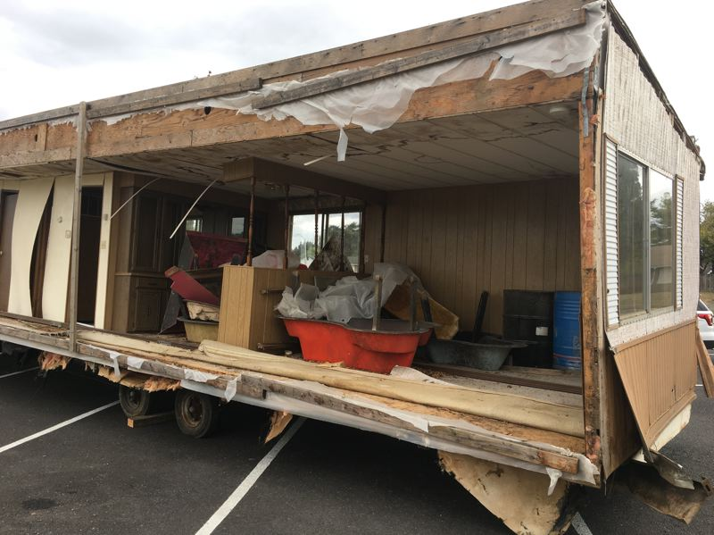 COURTESY PHOTO: WASHINGTON COUNTY SHERIFF'S OFFICE - Investigators are following up on leads regarding the as-yet-unexplained dumping of half of a double-wide mobile home outside Echo Shaw Elementary School on Saturday.