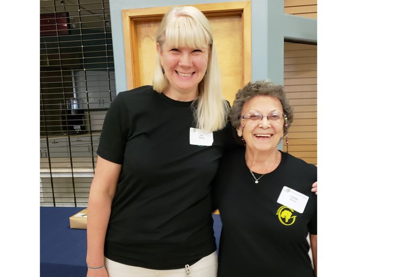 PHOTO COURTESY: LESLIE ROBINETTE - The Gladstone School District rewarded staff members, including technology specialist Jo Strong and cook Linda Daniels, with cash awards.