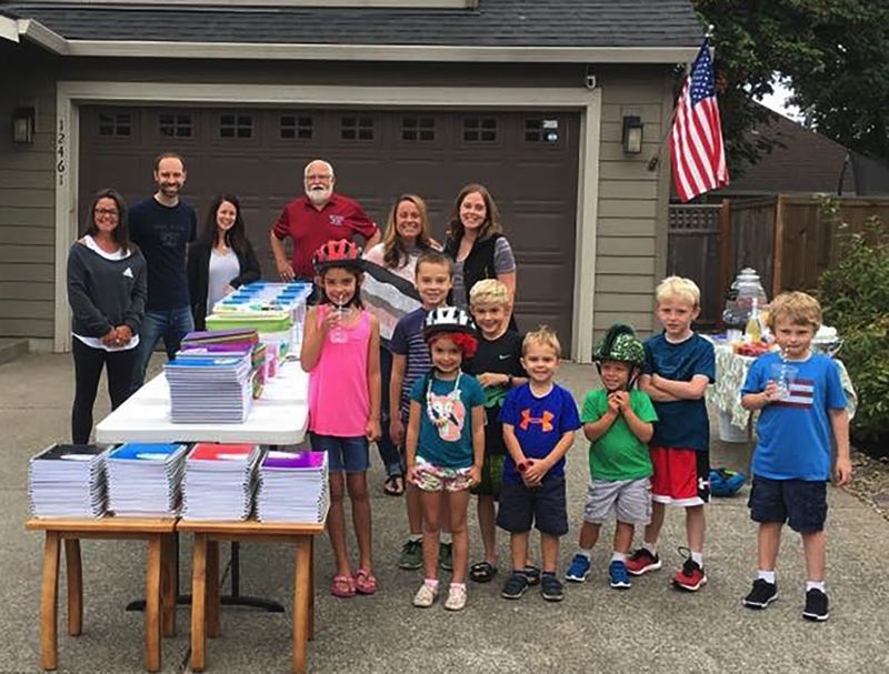 PHOTO COURTESY: MICHAEL CLARK - The Goshorn family organized a school supply drive with their McCarver Landing neighbors, and Adidas donated 50 backpacks. The supplies will benefit students attending Oregon City schools.