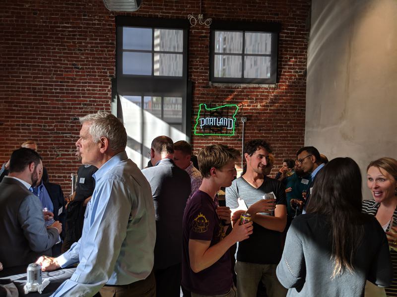 PAMPLIN MEDIA GROUP: JOSEPH GALLIVAN - Guests mingle in the offices of Autodesk before a series of talks and pitches about blockchain, the technology behind cryptocurrencies like Bitcoin. The state of Oregon has invested public money in the Oregon Blockchain Venture Studio. There hasnt been an Oregon land grab like this since marijuana was legalized.