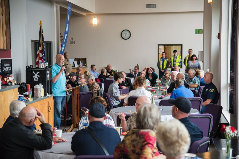 PHOTO BY: JAMIE SCHERSCHEL - Walt Fitch, the Oregon City Christian Church member who organized the Sept. 11 event, tells the crowd about the importance of honoring first responders.