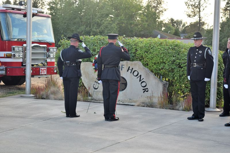 PHOTO BY: SHAWN DACHTLER - An honor guard from the Oregon City Police Department participates in the Sept. 11 event at the Red Soils Circle of Honor.