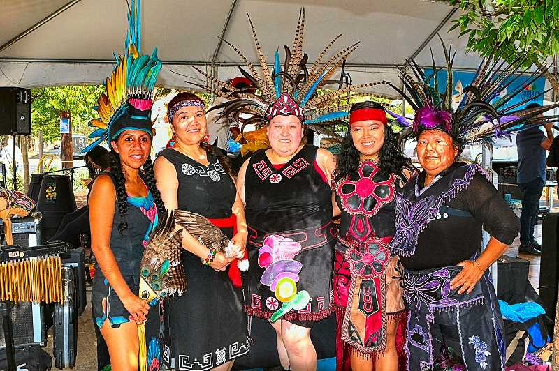 DAVID F. ASHTON - Members of the Huehca Omeyocan Aztec Dance group smile, before going on stage at the fiesta on S.E. Foster Road.