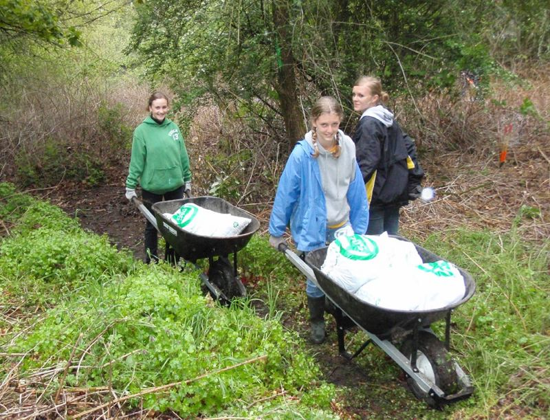 These three young ladies trundled wheelbarrows full of garbage that they collected in a recent SOLVE-sponsored cleanup in a nearby natural area.