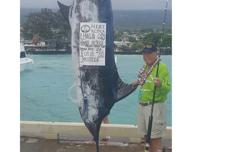 SUBMITTED PHOTO - Howard Dietrich, co-owner of the Mill End Store in Milwaukie, with his 652.1-pound Pacific blue marlin.