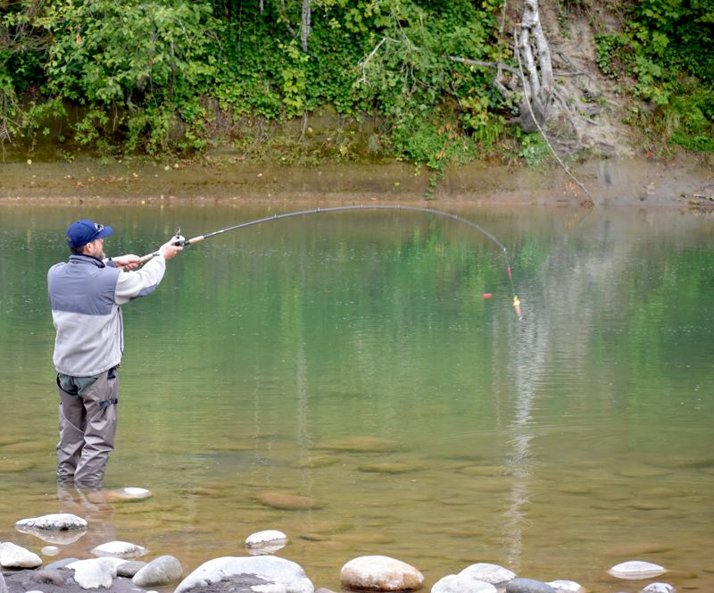 OUTLOOK PHOTO: MATT DEBOW  - Welches resident Troy Asher fishes for salmon and Steelhead on Saturday, Sept. 15.