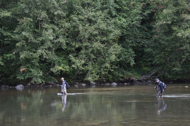 OUTLOOK PHOTO: MATT DEBOW - Two fisherman traverse the Sandy River in search of steelhead.