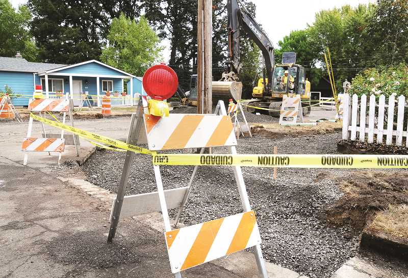 GARY ALLEN - Crews dig out sidewalks, curbs and gutters in preparation for replacement in the next few weeks.