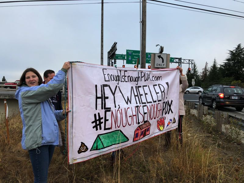 COURTESY MONTAVILLA INITIATIVE - Members of Montavilla Initiative display a banner criticizing Mayor Ted Wheeler's response to the homelessness crisis near the Glisan Street I-205 overpass on Monday, Sept. 17.