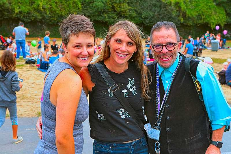 DAVID F. ASHTON - Welcoming everyone at the Llewellyn Elementary School back-to-school picnic were PTA Board Hospitality Chair Erin Hughes, PTA President Alisa Grammer, and Principal Joe Galati.