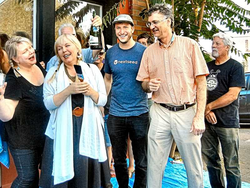 ELIZABETH USSHER GROFF - At an informal champagne celebration and painting party on September 8 for the forthcoming new Towne Crier restaurant, from left: Heidi Lawler, building manager; Tacee Cobb, owner; Stuart Ramsay is partially hidden, holding the champagne bottle; and Jeffrey Kaplan is wearing the nextseedfunding T-shirt.