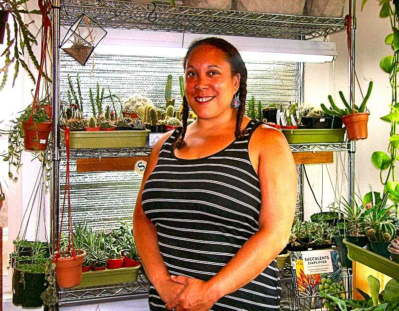 RITA A. LEONARD - Birds & Bees Nursery co-owner Amanda Simard, shown with cacti and succulents.