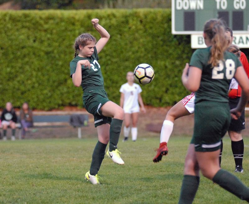 ESTACADA NEWS: MATT RAWLINGS - Emma Gillette battles to maintain possession of the ball in the first half of Estacada's game with Gladstone on Monday night.