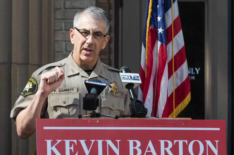 STAFF PHOTO: CHRISTOPHER OERTELL - Washington County Sheriff Pat Garrett speaks during a press conference for Kevin Barton on the steps of the Washington County Courthouse last year. Both Garrett and Barton oppose Ballot Measure 105.