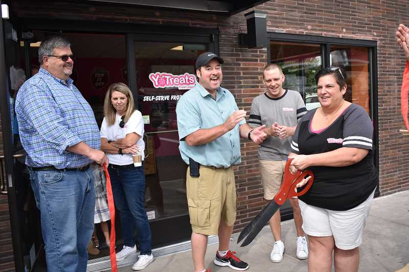ESTACADA NEWS PHOTO: EMILY LINDSTRAND - Community members are excited after the ribbon is cut during the grand opening of Yo Treats Frozen Yogurt last weekend.