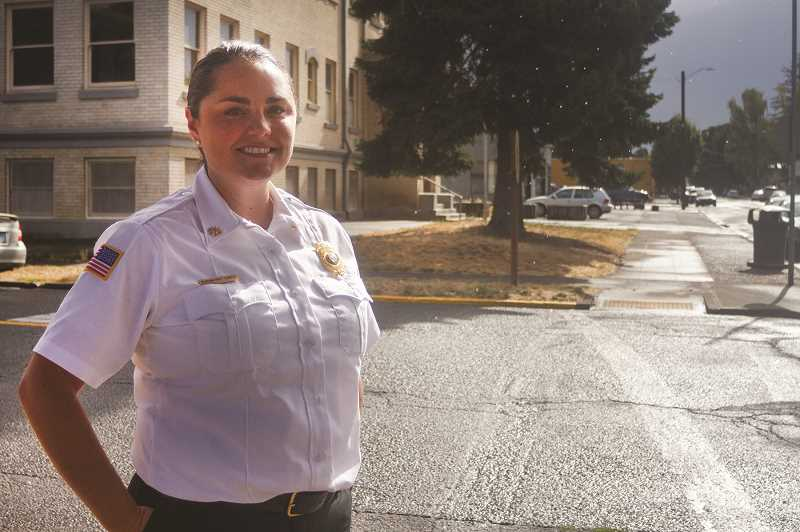 PATRICK EVANS - Woodburn native Mariana Ruiz-Temple stands in downtown Woodburn. She is now the chief deputy state fire marshal, and says her family encouraged her to succeed despite gender stereotypes.