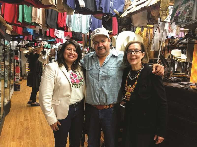 COURTESY ZOE BLUFFSTONE - Rep. Teresa Alonso Leon (left) and Gov. Kate Brown (right) visited a number of downtown Woodburn businesses on Saturday, including El Forastero, a footwear, clothing and leatherworks shop owned by Manuel Villanueva (middle).