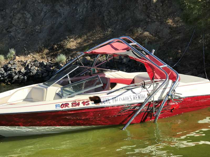SUBMITTED PHOTO - The 1995 Bayliner Capri 2005, owned by Cove Palisades Resort and Marina, was damaged in the June 24, 2017, crash at Lake Billy Chinook.