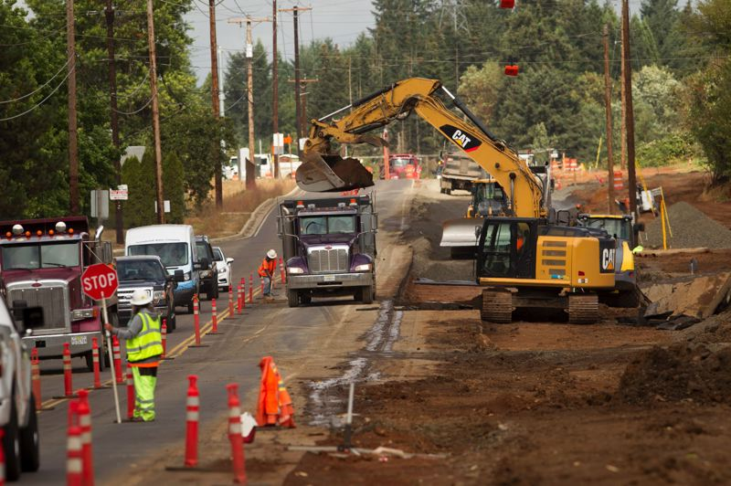 PORTLAND TRIBUNE: JAIME VALDEZ - Construction work continues on the widening of Southwest Grahams Ferry Road, one of several road projects that will improve access to industrial lands in the Basalt Creek area.