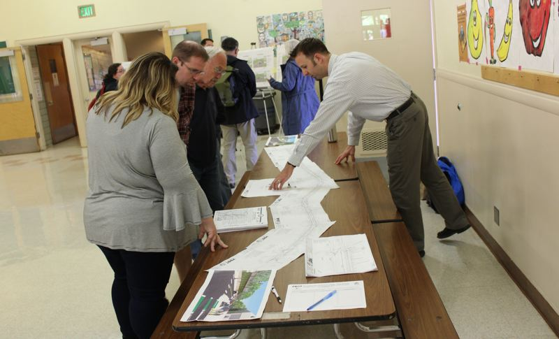 PAMPLIN MEDIA GROUP: COREY BUCHANAN - The Portland Bureau of Transportation revealed designs for improvements to Capitol Highway during an open house at Markham Elementary School.