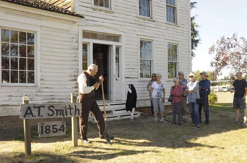 COURTESY PHOTO: FRIENDS OF HISTORIC FOREST GROVE - Reenactors entertain visitors outside the Alvin T. Smith House on Elm Street, one of the oldest buildings in Forest Grove.