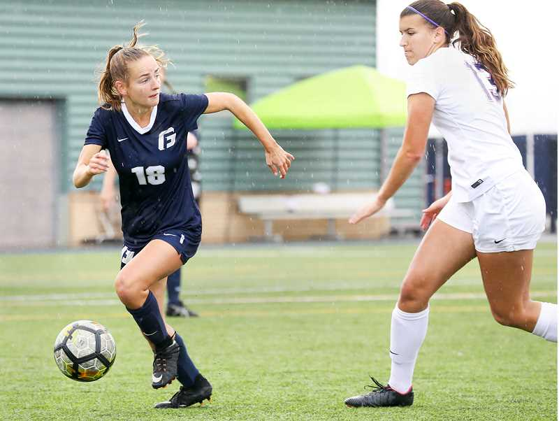 PHOTO COURTESY OF GFU - Freshman midfielder Megan Harrington heads up field during George Fox's 0-0 draw Sunday versus Linfield.