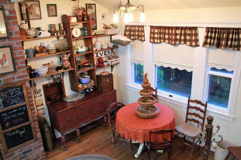 COURTESY PHOTO: DON AND ELENA IVES - The sitting area of the I.L. Smith Home features a dumbwaiter that was converted into shelves for holding antiques.