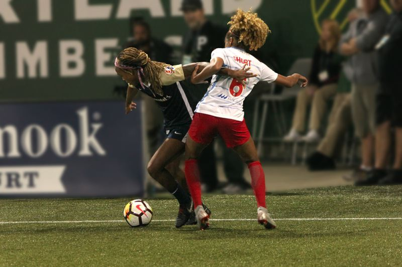 COURTESY: JAN LANDIS/ASIAN REPORTER - Jessica McDonald (left) of the North Carolina Courage battles to get around Casey Short of the Chicago Red Stars during Tuesday night's NWSL semifinal at Providence Park.