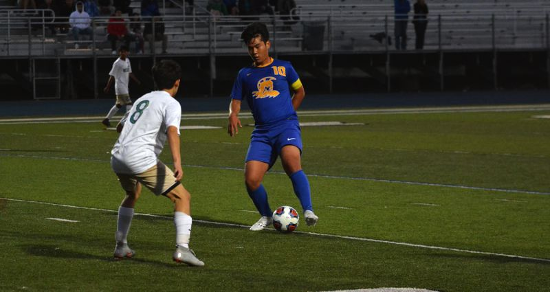 TIMES PHOTO: MATT SINGLEDECKER - Aloha midfielder Parkin Harape looks for open space against the McKay defense on Monday.