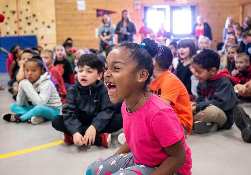 PHOTO COURTESY OF BRUCE ELY/PORTLAND TRAIL BLAZERS - First-grader Anna Laiya Williams Orozco, and other Madras Elementary School students, get excited during an assembly with Blazer activities in the gym prior to the Blazers' Rip City Rally, from 4-6 p.m.