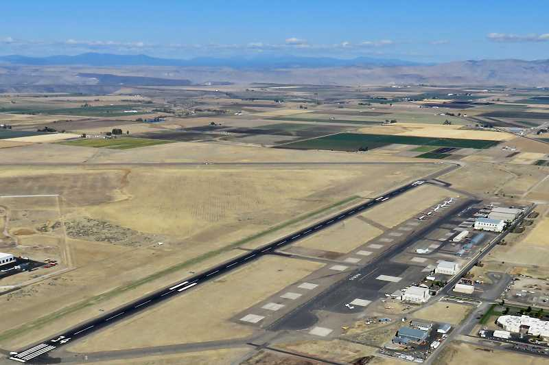 PHOTO BY PHIL COMINGORE - The Madras Municipal Airport, as viewed from the air, has received a grant to reconstruct the airport taxiways. The General Aviation Building is the second building from the lower right corner.