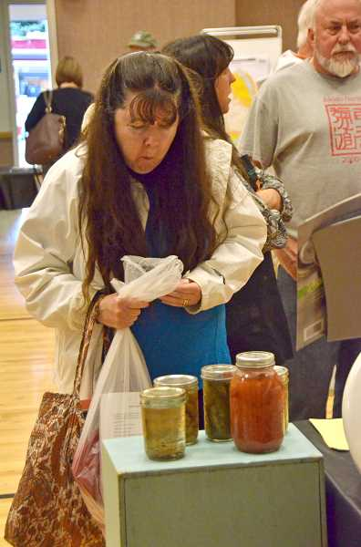 TIDINGS PHOTO: VERN UYETAKE - Larraine Clark learns about food preservation.